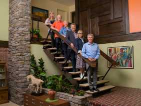 "This image released by HGTV shows the cast of ""The Brady Bunch,"" from left, Susan Olsen, Mike Lookinland, Eve Plumb, Christopher Knight, Maureen McCormick, and Barry Williams. The cast will join forces with HGTV stars including Jonathan and Drew Scott for a makeover on the house used for exterior shots in the 1969-74 sitcom. ""A Very Brady Renovation,"" premieres on HGTV, Sept. 9. (Matt Harbicht/HGTV via AP)"